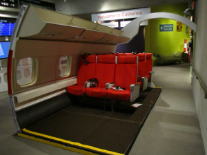 "The cabin of a vintage airplane featured in the interactive installation ""Immigration after 1975"" in OMCA Gallery of California History. Photo: Diana Gadaldi."